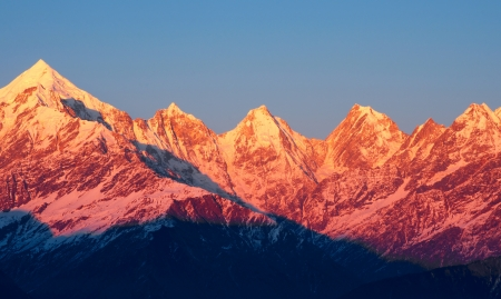 close up of five snow clad mountain peaks