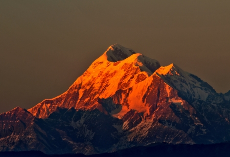 sunset scene over Mountain  Trishul  in Indian Himalayas