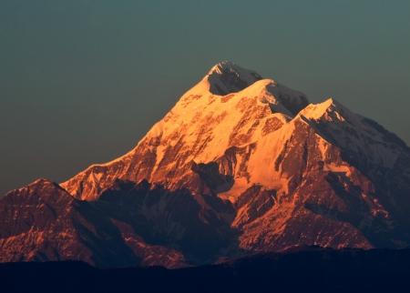 sun set scene over mountain  Trishul  in Indian Himalaya Stock Photo