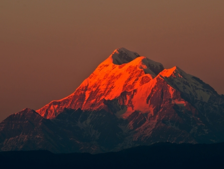 sun set scene over mountain  Trishul  in Indian Himalaya Stock Photo