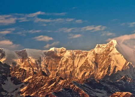 sun ray illuminating mount Maiktoli in Indian Himalaya