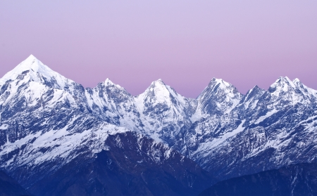 panchachuli peaks against purple background