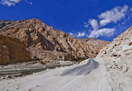 wide shot of barren mountain in  Ladakh  with broken road