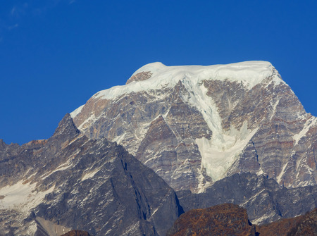 close shot of  Hanthi Parvat  against blue sky in Indian Himalaya Stock Photo