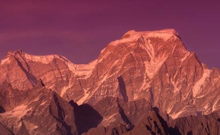 Sunset over  Hanthi and Ghori  peaks in Indian Himalaya