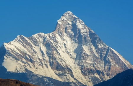 Mountain peak  Nanda devi  against blue sky