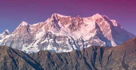 partially red Mountain  Chaukhambha  During sunset in Himalaya Stock Photo
