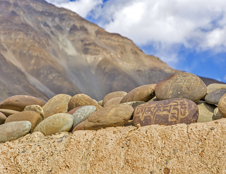 rocks inscribed with Buddhist mantras