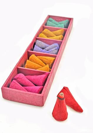 close up of colorful incense cones