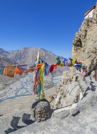 gompa: colorful Buddhist prayer flags decorated at the top of Dhankar Gompa Himachal pradesh
