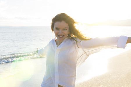 Happy woman on the beach photo