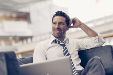 Portrait of a businessman relaxing Standard-Bild