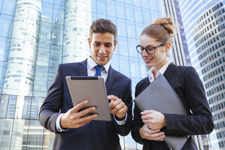 portable information device: Business meeting people and sharing ideas