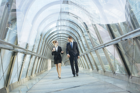 Business people walking in a financial dristrict