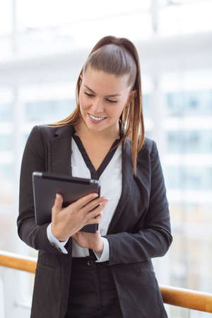 portability: Portrait of a businesswoman using a digital tablet