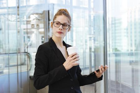 having a break: Businesswoman Having a coffee break