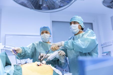 endoscopy: Surgeons performing surgery in operating Theater.