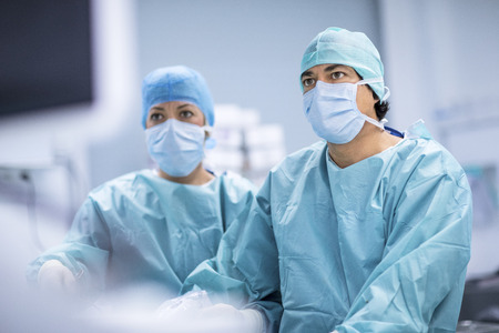 Surgeons performing surgery in operating Theater.