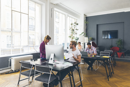 Young business people working at office on new project Standard-Bild