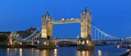 The Tower Bridge illuminated at dusk in London, England.