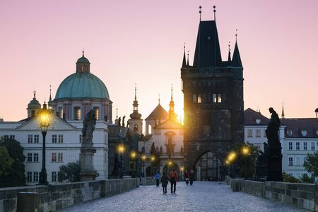 Prague, Charles Bridge and spires of The Old Town at sunrise 写真素材