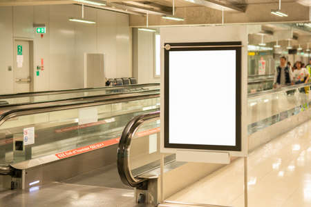 Blank advertising billboard at airport,mockup poster media template ads display
