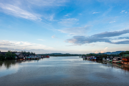 Beauty sky and Fishing boats on the rivers of Thailand.