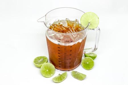 Glass of ice tea with lemon on white background Stock Photo