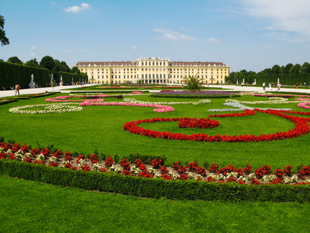 habsburg: Vienna, Austria - June 17, 2012: People visit the flowering garden in front of the Schonbrunn Palace, the former  Habsburg residence. Palace and Gardens of Schonbrunn are UNESCO World Heritage site.