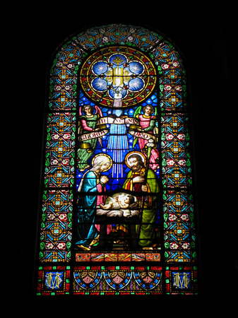 virgin of montserrat: Montserrat, Catalonia, Spain - September 09, 2014: Nativity scene.  Old beautiful  stained glass window in the  Basilica of  the famous Benedictine Monastery   Montserrat, located in the mountains 56 km from the city Barcelona.