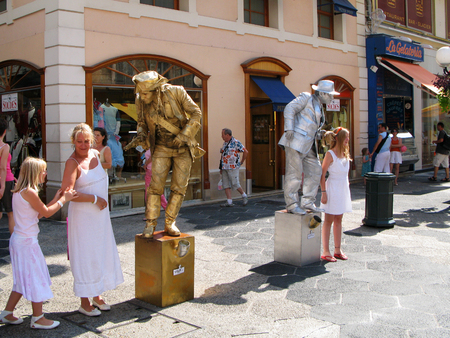 Nice, France -19 July, 2007: Two street actors in the image of living statues entertain tourists and passersby on the street Massena in the city Nice.