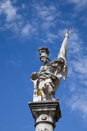 Bottom view of the St. Florian statue against the blue sky with clouds on Old Market Square (Alter Markt) in the Historic Centre of the Salzburg, Austria. St. Florian is the patron of firefighters. Banque d'images