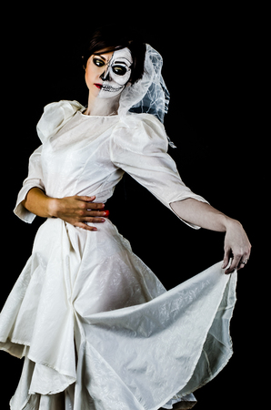 skeleton costume: Young woman in day of the dead mask skull face art.