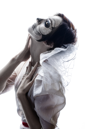Young woman in day of the dead mask skull face art. Stock Photo - 87954364