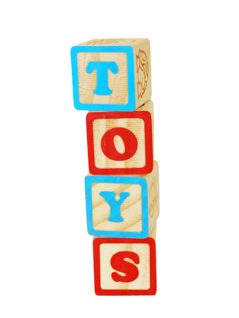 stacked up: wooden toy blocks stacked up to spell the word toys