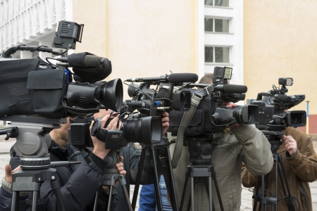 news reporter: Covering an event with a video camera