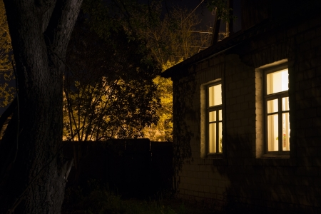 lighted: Night view of the rural house with lighted windows