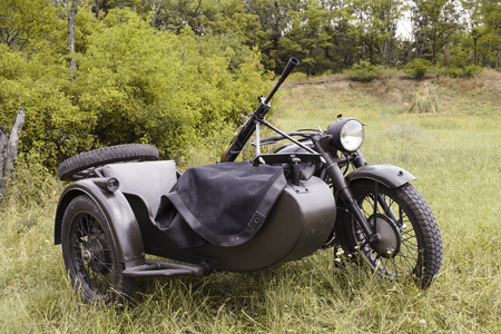 Old-fashioned Soviet motorcycle with sidecar since the Second World War, mounted with a machine gun. photo