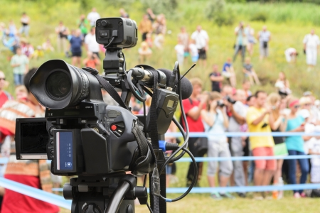 Covering an event with a video camera. photo