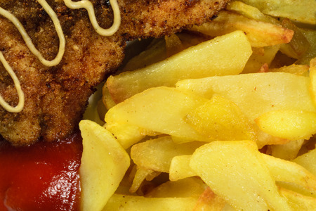 French fries with chicken chops. Close-up view. photo