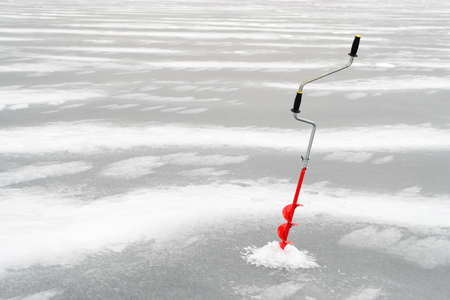 boer: Fishing tackle for ice fishing such as a boer in the ice