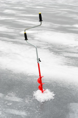 boer: Fishing tackle for ice fishing such as a boer in ice