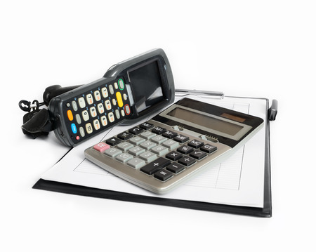 clerical: Business still life with barcode scanner, clerical clipboard and electronic calculator on white background