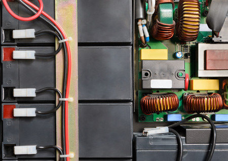 hooked up: Industrial electronic device with batteries hooked up with red and black cables