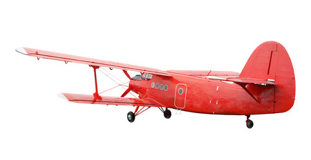 Back side view of red airplane biplane with piston engine and propeller. Isolated on white background Stock Photo