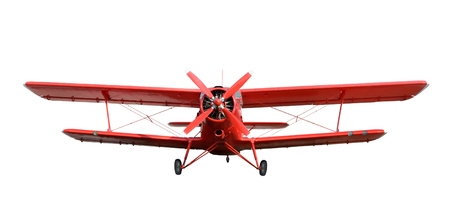 Front view of red airplane biplane with piston engine and propeller. Isolated on a white background Reklamní fotografie