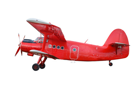 Side view of red airplane biplane with piston engine and propeller. Isolated on white background Reklamní fotografie