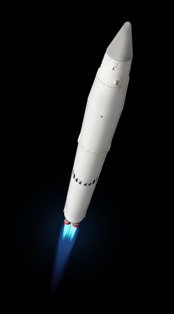 Flying multistage space rocketwith fire trail. Isolated on a black background Stock Photo