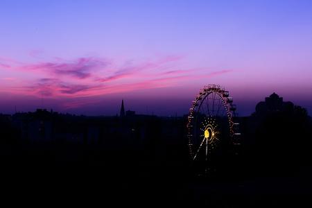 ferriswheel: Sunset silhouette of Ferris wheel in Odessa, Ukraine