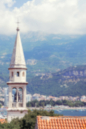 balkans: The bell tower of Sveti Ivan (St.John) Catholic Church Cathedral, view from top of citadel old town of Budva in Montenegro; blurred background Stock Photo